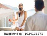 attractive woman drinking... | Shutterstock . vector #1024138372