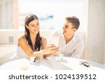 attractive couple having first... | Shutterstock . vector #1024139512