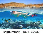 young woman at snorkeling in... | Shutterstock . vector #1024139932