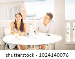 attractive couple having first... | Shutterstock . vector #1024140076