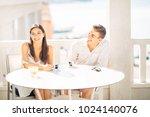 attractive couple having first... | Shutterstock . vector #1024140076