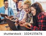 young volunteers help senior... | Shutterstock . vector #1024155676