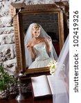 beautiful bride wearing white... | Shutterstock . vector #102419326