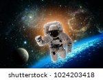 astronaut flies over the earth...   Shutterstock . vector #1024203418