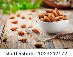 almonds in white porcelain bowl ... | Shutterstock . vector #1024212172