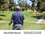 golfer looking at course | Shutterstock . vector #1024221235