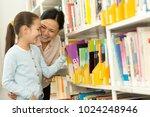 pretty little girl picking... | Shutterstock . vector #1024248946