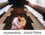 the girlfriend kisses her... | Shutterstock . vector #1024275946