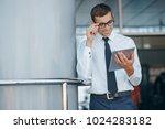 businessman going over meeting... | Shutterstock . vector #1024283182
