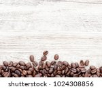 coffee beans on wood background | Shutterstock . vector #1024308856
