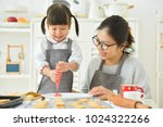 happy asian kid and young...   Shutterstock . vector #1024322266