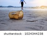 tourists with plastic garbage... | Shutterstock . vector #1024344238