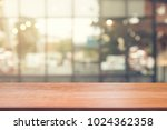 wooden board empty table top on ... | Shutterstock . vector #1024362358