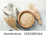 rolled oats in wooden bowl and... | Shutterstock . vector #1024383166