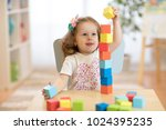 cute child stacks building... | Shutterstock . vector #1024395235