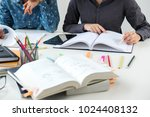 tutor books with friends  young ... | Shutterstock . vector #1024408132