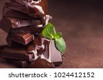 melted chocolate pouring into a ... | Shutterstock . vector #1024412152
