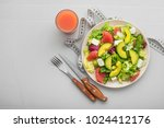 fresh healthy salad with... | Shutterstock . vector #1024412176