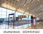 Small photo of Empty terminal halls at Airport, waiting for passengers and arrival, departure board to acknowledge traveler, tourism for flight timetable which are on time or delay.