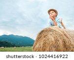 careless boy lies on haystack...   Shutterstock . vector #1024416922