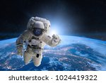 astronaut in outer space on... | Shutterstock . vector #1024419322