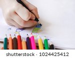 the child draws with colored... | Shutterstock . vector #1024425412
