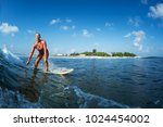 happy surfer rides the clear... | Shutterstock . vector #1024454002