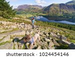 Small photo of A hiker and dog on route to the summit of Red Pike with views of Lake Buttermere, Robinson, Whiteless Pike, Wandope and Grasmoor in the distance. The English Lake District, UK.