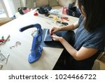 girl cutting piece of leather... | Shutterstock . vector #1024466722