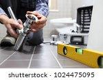 hands plumber at work in a... | Shutterstock . vector #1024475095