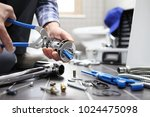 hands plumber at work in a... | Shutterstock . vector #1024475098