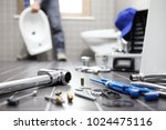 plumber at work in a bathroom ... | Shutterstock . vector #1024475116