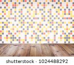 wooden table top over colorful... | Shutterstock . vector #1024488292