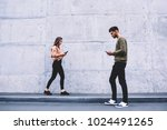 young people walking on street... | Shutterstock . vector #1024491265