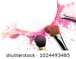 Small photo of Traces of vibrant pink powder and blush forming a frame, with makeup brushes and a place for text. A template for a makeup artist's business card or flyer design, with copy space