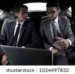 two businessman talking while... | Shutterstock . vector #1024497832