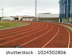 red running track in sport... | Shutterstock . vector #1024502806