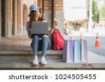 young women sitting on the... | Shutterstock . vector #1024505455