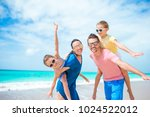 happy beautiful family of four... | Shutterstock . vector #1024522012