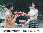 girlfriend preparing to gift... | Shutterstock . vector #1024533376