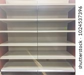 empty shelves at grocery store... | Shutterstock . vector #1024537396