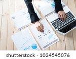 business women reviewing data... | Shutterstock . vector #1024545076