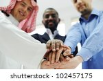 business team overlapping hands | Shutterstock . vector #102457175