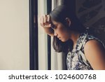 woman feeling sad at window .... | Shutterstock . vector #1024600768