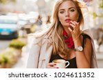 thoughtfully blonde woman with...