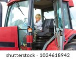 little blond boy in tractor ... | Shutterstock . vector #1024618942