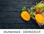 mango. tropical fruits. on a...   Shutterstock . vector #1024623115