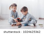 children play with a toy... | Shutterstock . vector #1024625362