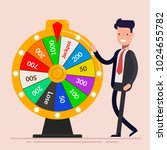 businessman with fortune wheel. ... | Shutterstock .eps vector #1024655782