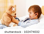 a sick child examined teddy... | Shutterstock . vector #102474032